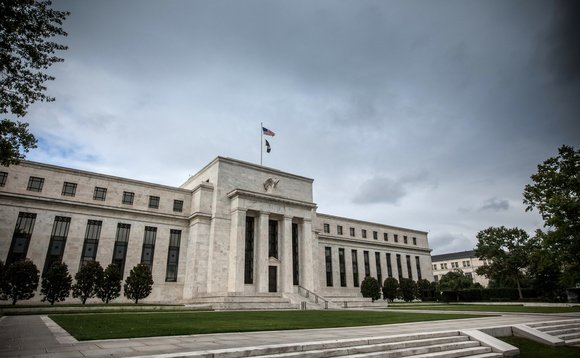 The Fed said further action on the economy was dependent on the spread of the coronavirus